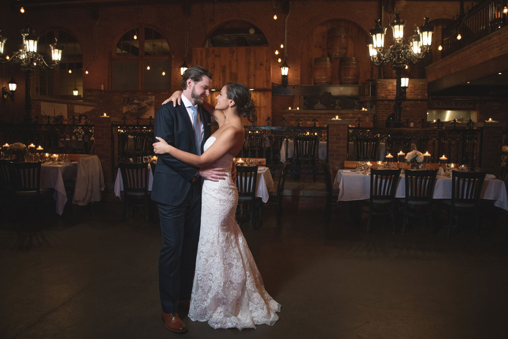 newly wed couple sharing their first dance on an empty dancefloor