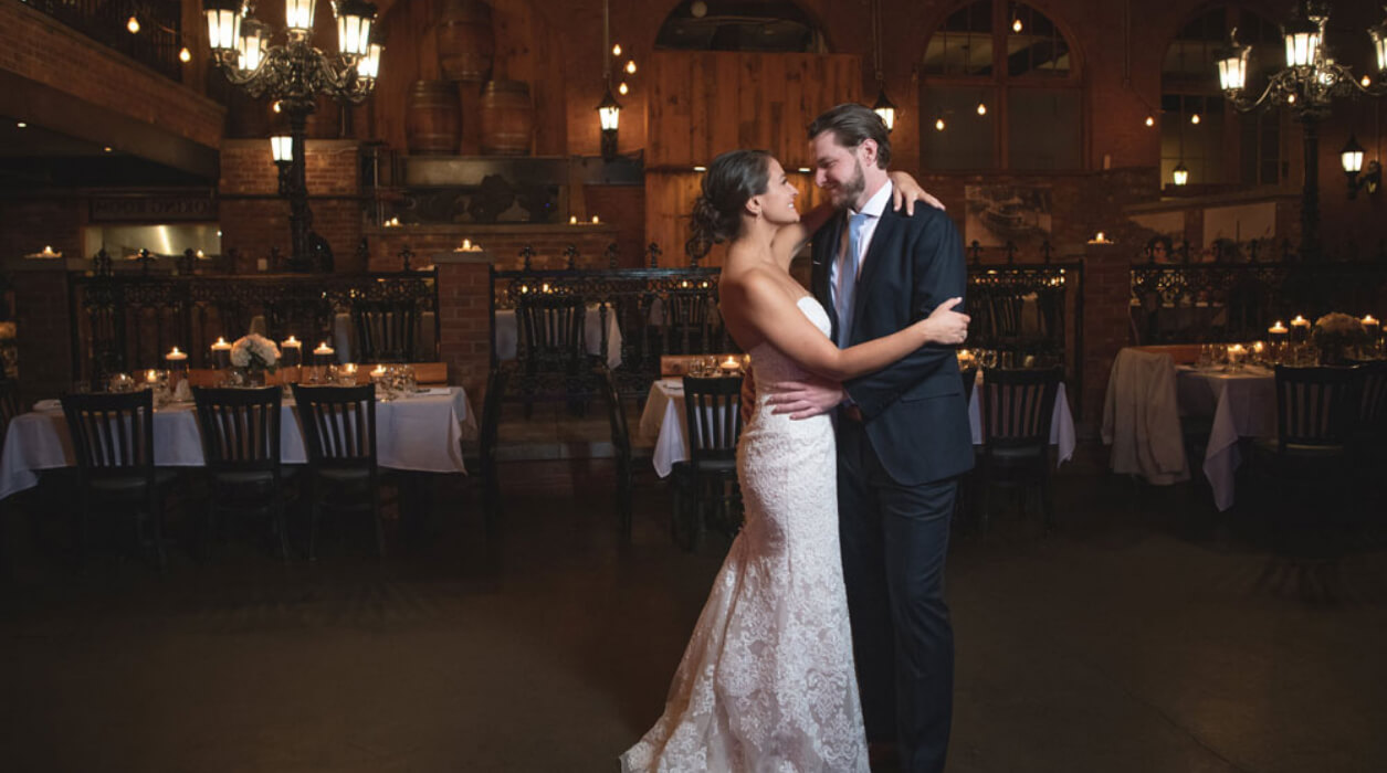 newly wed couple share the dance floor for the very first time